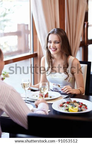 The happy couple in the restaurant - stock photo