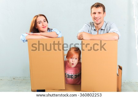 The happy family  during repair and relocation - stock photo