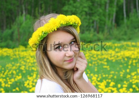 The happy girl with first spring flower - stock photo
