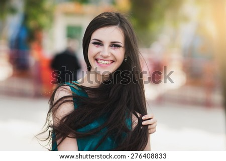 the happy girl with long hair and a creative make-up - stock photo