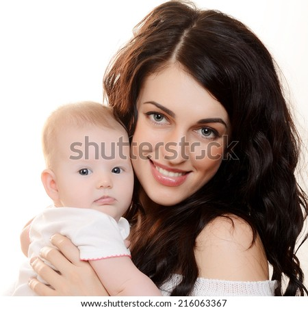 The happy mother with baby on white background - stock photo