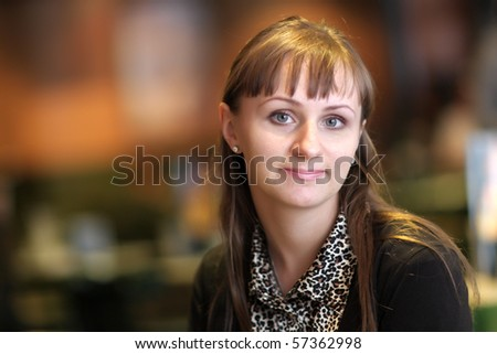 The happy russian young woman poses indoor - stock photo
