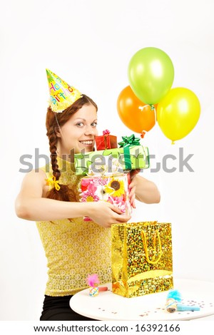 The happy young girl holds in hands set of boxes with gifts on a white background - stock photo