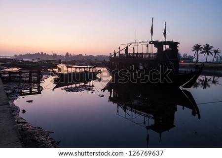 The harbor of Hoi An before sunrise. Hoi An is an UNESCO World Heritage site in Vietnam. - stock photo