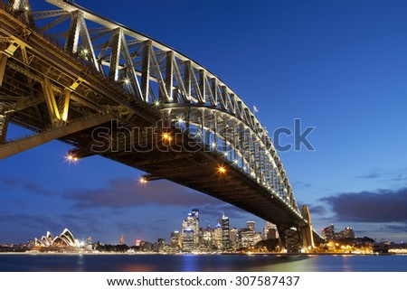 The Harbour Bridge, Sydney Opera House and Central Business District of Sydney. Photographed at dusk. - stock photo