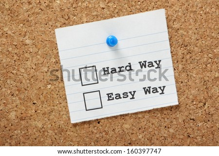 The Hard Way or the Easy Way tick boxes on a paper note pinned to a cork board. The choice between using Best Practice and efficiency or continuing to do it the wrong way.  - stock photo