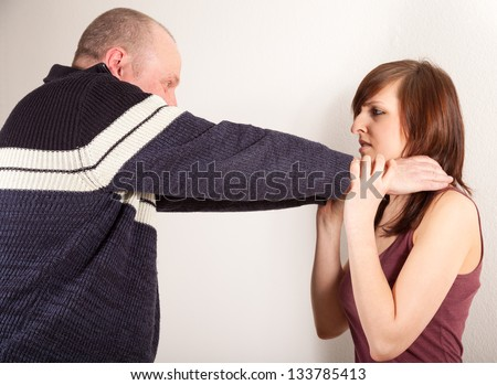 The has his hand around the daughters neck - stock photo