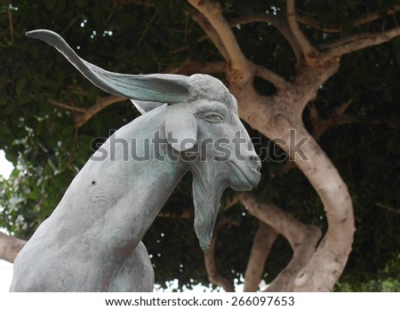 The head of a sculpture of a goat in the Streets of Puerte del Rosario on Fuerteventura - stock photo