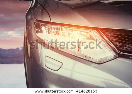 The headlights and the hood of a sports car. - stock photo