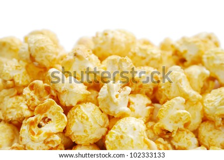 The heap of popcorn isolated on white background - stock photo