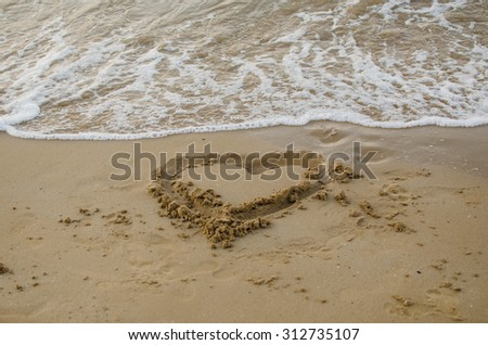 The heart draw in the sand on the beach in Italy - stock photo