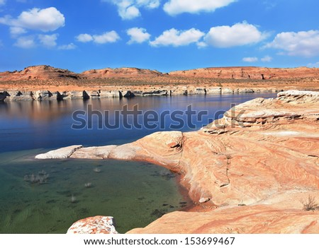The heat. The artificial Lake Powell in the red desert of California.  Photo taken fisheye lens - stock photo