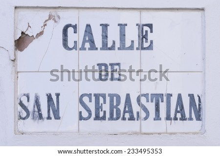 The heavily weather beaten tile street marker identifying Calle de San Sebastian in Old San Juan, Puerto Rico - stock photo
