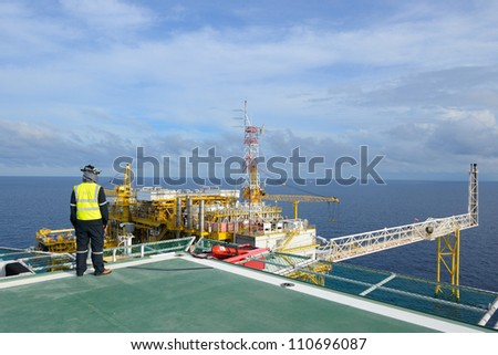 The helicopter landing officer is on the oil rig platform in the gulf of thailand. - stock photo