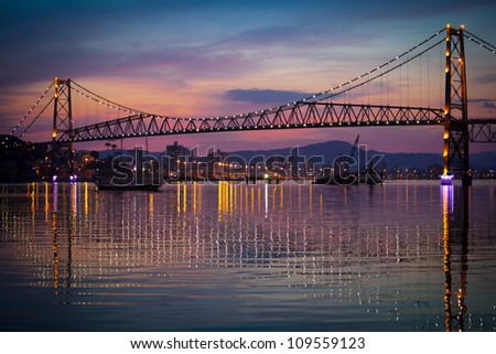The Hercilio Luz Bridge, in Florianopolis, Brazil, with an amazing sunset. - stock photo