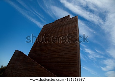 The high wooden house resting against the sky - stock photo