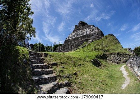 The highest temple in Xunantunich, an ancient Mayan archeological site in western Belize, rises over 130 ft. The city was a ceremonial center that was abandoned around AD 750 due to a violent event. - stock photo