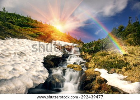 The highest waterfall in Ukraine - on the Prut River, under the top Goverly- Montenegrin Ridge, bushes creeping pine and alder rumbles rough water when the snow melts. - stock photo