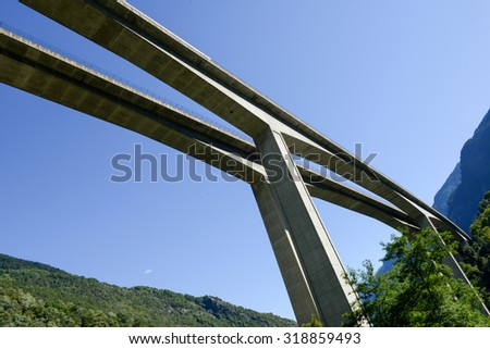 The highway bridge at Giornico on the swiss alps - stock photo
