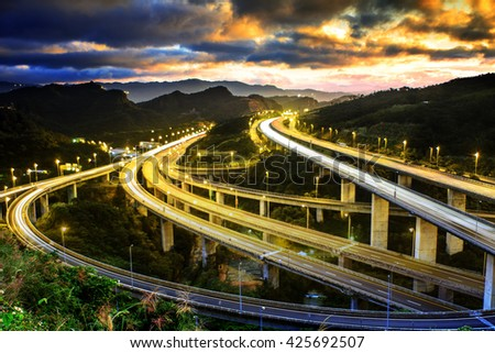 The Highway in night with cars light in modern city in Taiwan, Asia - stock photo