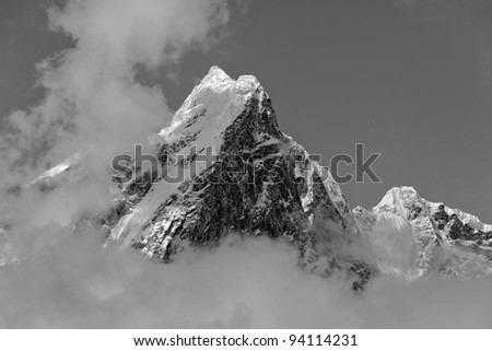 The himalayan mountain in the clouds (black and white) - Nepal, Humalayas - stock photo