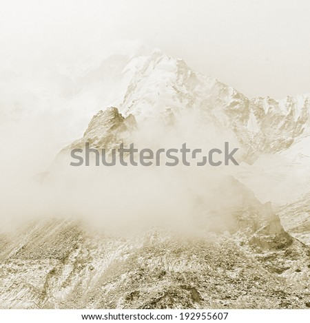 The himalayan peak near Mount Everest in the fog - Nepal (stylized retro) - stock photo