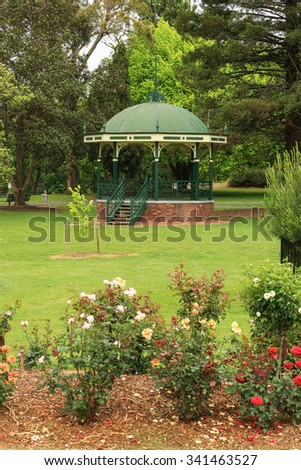 The historic band rotunda in the gardens of Victory Park in Traralgon, Victoria, Australia. - stock photo
