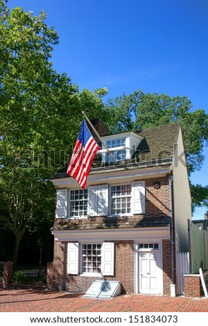The historic Betsy Ross house tourism landmark with hanging American flag in Old City Philadelphia in Pennsylvania - stock photo