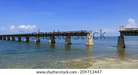 The historic Florida Overseas Railroad, converted for automobile traffic in 1935, still stands today, though some sections are missing. - stock photo