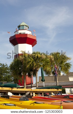 The historic Harbor Town Lighthouse on Hilton Head Island, South Carolina. - stock photo