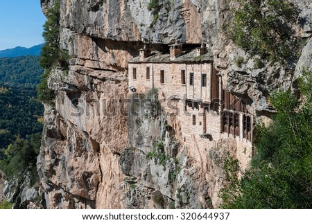 The historic Kipina Monastery (12th century), built on a cliff of the Tzoumerka mountains in Epirus, Greece - stock photo