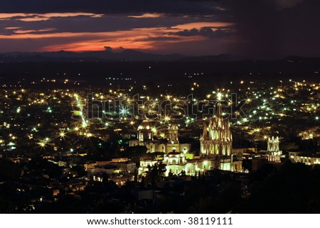 The historic Mexican city of San Miguel de Allende with the La Parroquia (Church of St. Michhael the Archangel) in foreground. - stock photo
