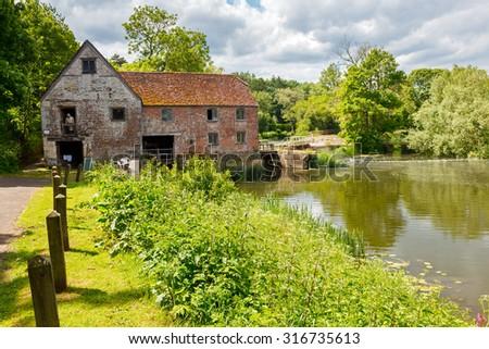 The historic Sturminster Newton Mill Dorset England UK Europe - stock photo