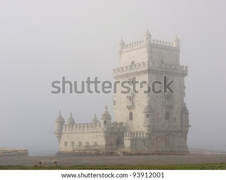 The historic tower of Belem in Lisbon in Portugal in a early morning fog - stock photo