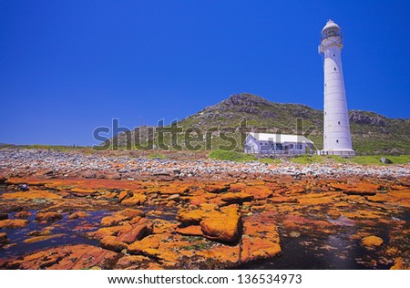 The Historical Slangkop Lighthouse at Kommetjie in the Western Cape, South Africa - stock photo