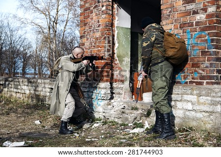 The hitmen captured ruined house with zombies - stock photo