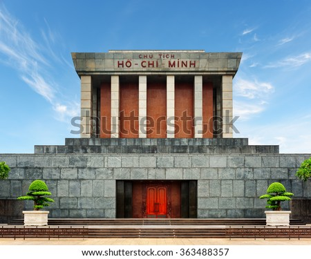 The Ho Chi Minh Mausoleum in centre of the Ba Dinh Square in Hanoi, Vietnam. Blue sky in background. The Ho Chi Minh Mausoleum is a popular tourist destination of Asia. - stock photo