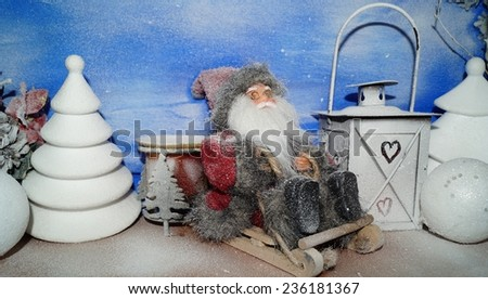 The Holy Santa on a sleigh - on a blue background - Christmas background - stock photo