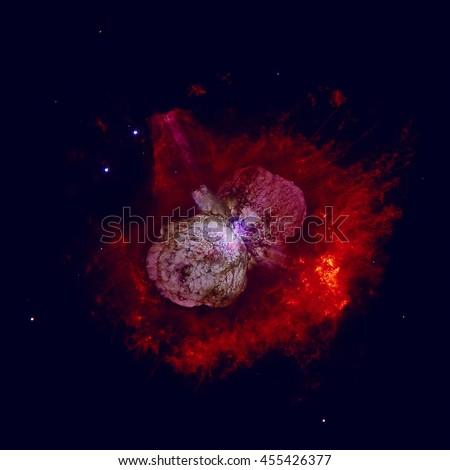 The Homunculus Nebula is a bipolar emission and reflection nebula surrounding the massive star system Eta Carinae. Retouched colored image. Elements of this image furnished by NASA.  - stock photo