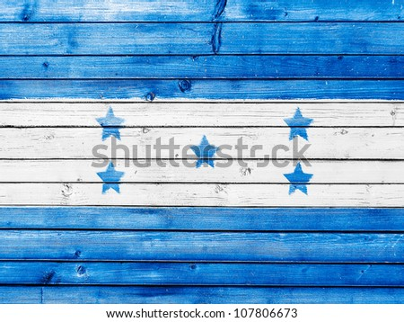 The Honduran flag painted on wooden fence - stock photo