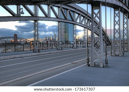The Honsellbruecke at dusk with the new ECB (European Central Bank) and Frankfurt skyline in the distance. - stock photo