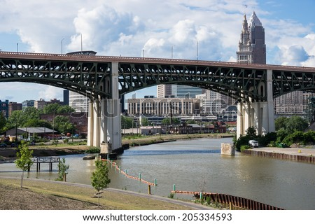 The Hope Memorial Bridge that spans the Cuyahoga River with a portion of the downtown Cleveland business district in the background seen from the Scranton Flats Towpath recreation area - stock photo
