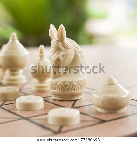 the horse on chess board is Knight in army - stock photo