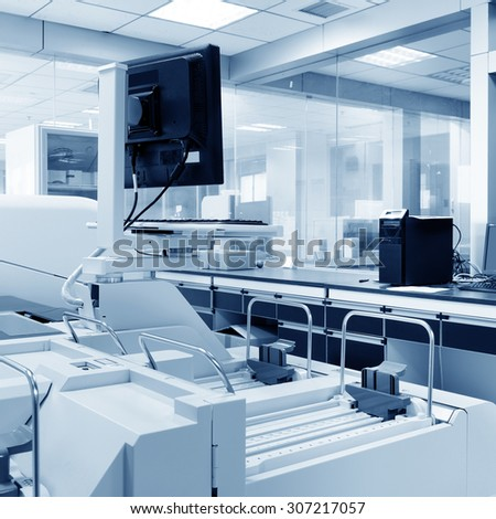 The hospital's laboratory, biochemical analyzer and computer work. - stock photo