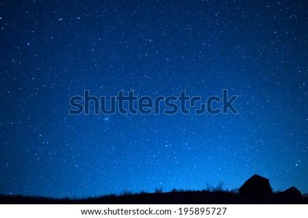The house  against the star sky. - stock photo