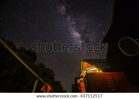 The house and milky way at night. The outstanding beauty and clarity of the Milky Way, with close up of the its colorful core. Long exposure captured from Thailand - stock photo