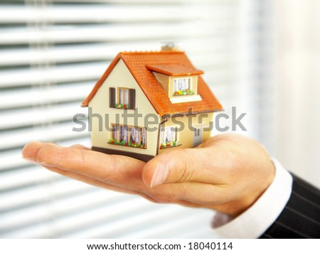 The house in human hands - stock photo