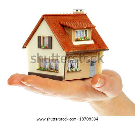 The house in human hands... - stock photo