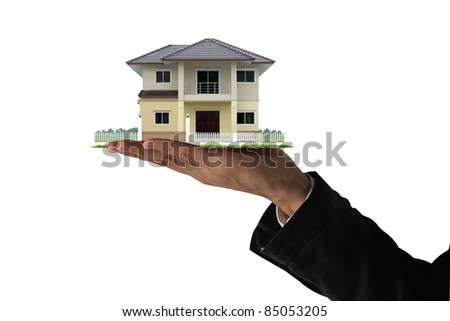 The House in the human hands. - stock photo