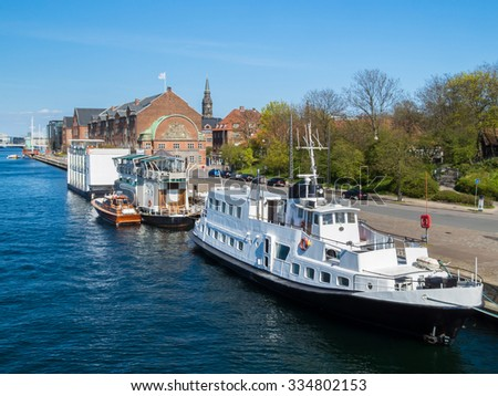 The houseboats and ships on the channel of Copenhagen, Denmark - stock photo